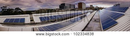 Panorama of solar panels on rooftop
