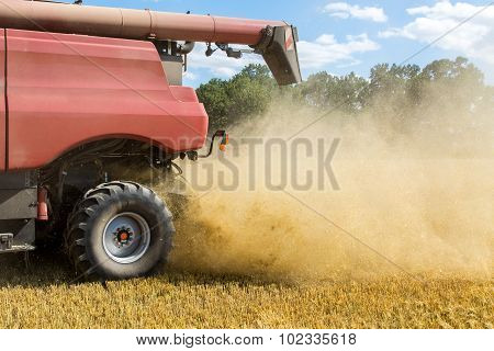 Combine Working On The Wheat Field
