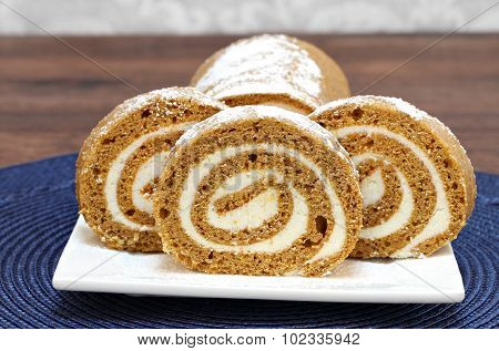 Slices Of Fresh Baked Pumpkin Roll Cake.