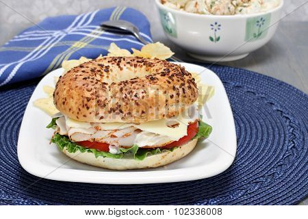 Turkey, Lettuce, Tomato And Swiss Cheese Sandwich On An Onion Bagel.