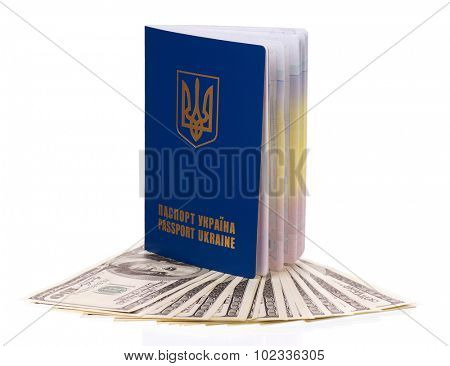 International Ukrainian passport with US dollars banknotes isolated on white background