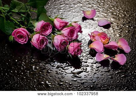 Roses On A Black Glass