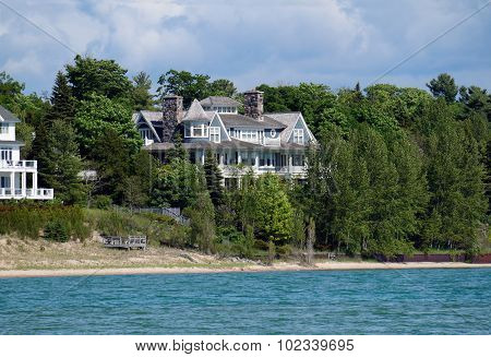 Lakefront Mansion Behind Trees