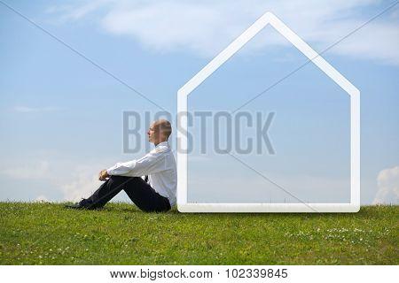 Businessman contemplating in park