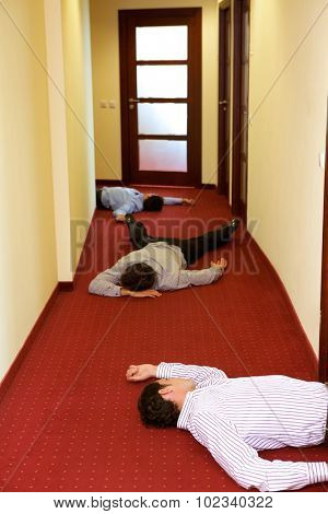 Three businessman lying down in office