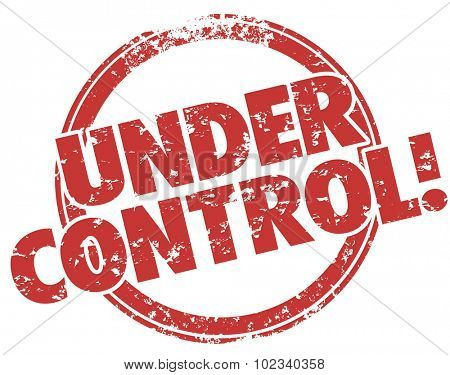 Under Control words stamped in red grunge style ink to illustrate work, job, task or project well managed and making progress