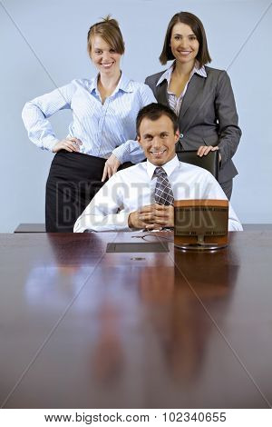 Portrait of business people smiling at office