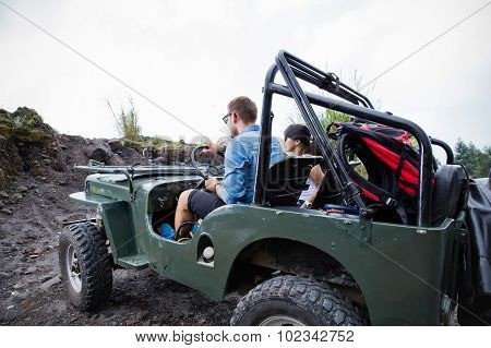 Mixed Couple Riding A Jeep Off Road