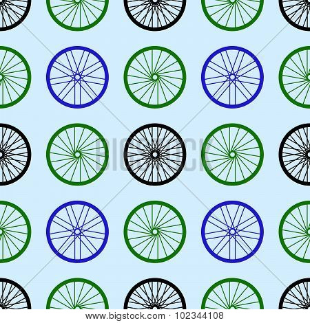 Seamless pattern with bike wheels. Bicycle wheels with colored rims and spokes. Vector illustration.