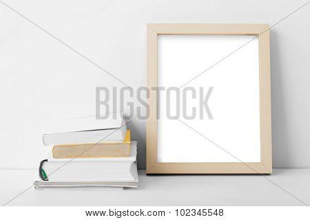Desk Blank Photo Frame Nest To Stack Of Books