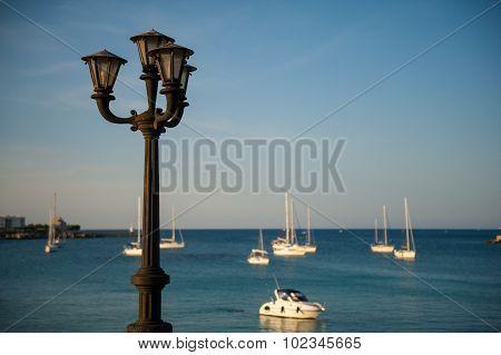 Old Lamp In Quiet Harbor