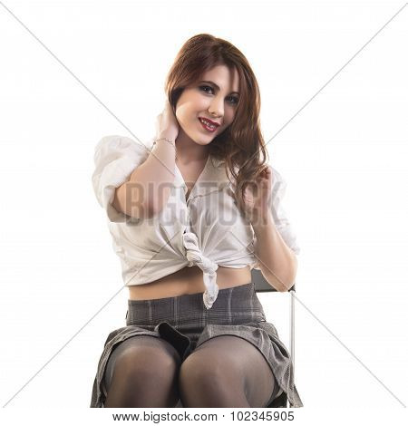 Sexy Young Woman Sitting On Chair