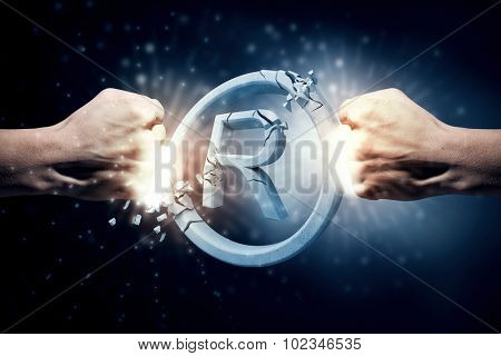 Close up of human hand hitting rights sign with fist