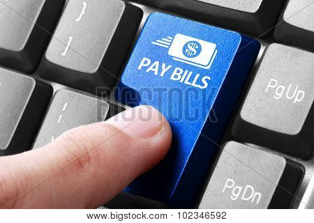 Hand Press Pay Bills Button On Keyboard