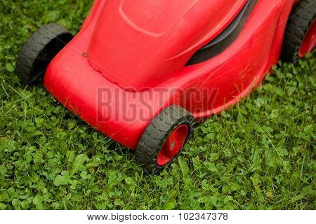 Red Lawnmower On Green Grass