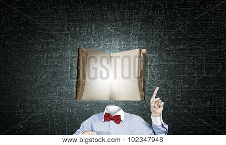 Unrecognizable man with book instead of his head