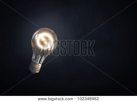 Glass glowing light bulb with prohibition sign inside