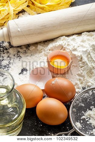 Flour, Rolling Pin And Raw Egg Yolk