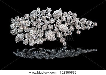 silver brooch with diamonds