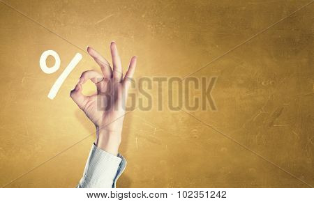 Percentage symbol and hand showing ok gesture