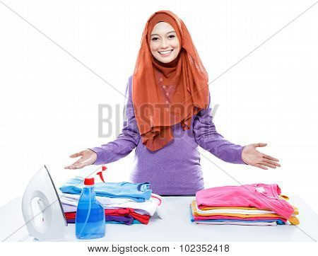 Young Woman Wearing Hijab Presenting Clean And Tidy Clothes After Ironing