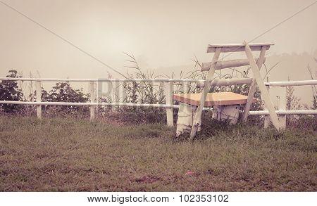 White Bench In Foggy Morning