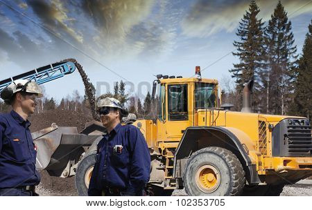 construction workers, machines and building site