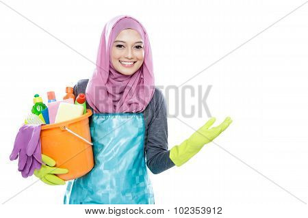 Housewife Wearing Hijab Holding Bucket Full Of Cleaning Supplies And Presenting Copy Space