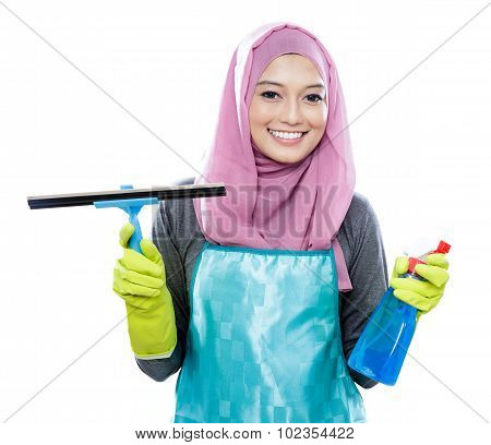 Young Woman Wearing Hijab Holding Squeegee And Cleaning Spray