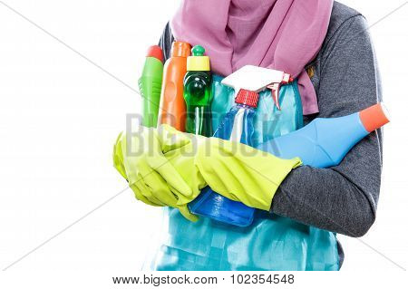 Housewife Carrying Many Bottles Of Cleaning Fluid