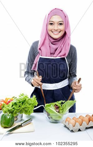 Young Woman Preparing Making Salad