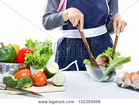 Housewife Making Salad For Dinner