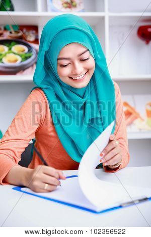 Beautiful Muslim Woman Writing On Paper