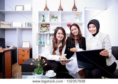 Happiness Of Three Young Businesswomen Discussing Their New Job