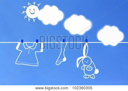Format Of Clothes Hanging On A Washing Line With Blue Sky And White Fluffy Clouds