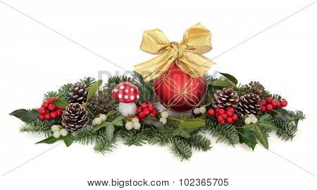 Christmas bauble decorations, holly, mistletoe, ivy, pine cones and traditional greenery over white background.
