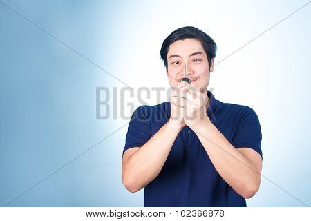 Asian Handsome Man With The Keys Of His New Car, On Blue Background