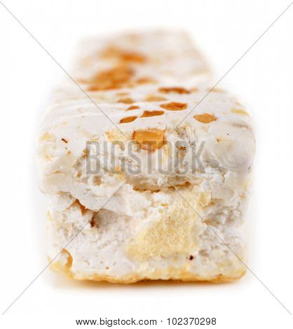 Sweet nougat with hazelnuts isolated on white