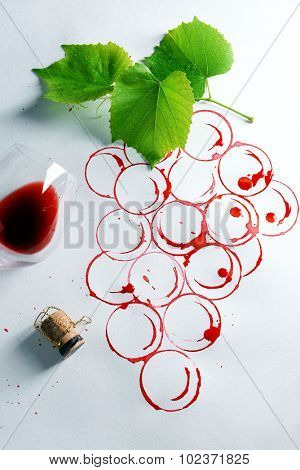 Grapes made with wine cork and goblet of spilled wine