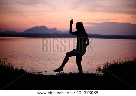 River and Silhouette Woman
