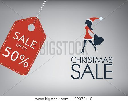 Christmas sale poster. Holiday sales vector template. Sexy woman in santa dress and hat with shoppin