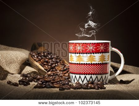 Christmas Cup With Coffee Beans On Dark Background