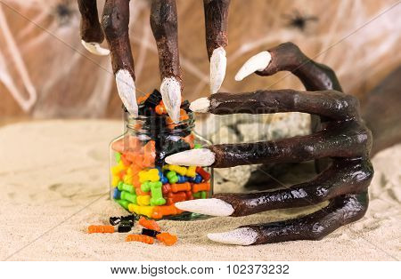Halloween Witch Hands And Colorful Candies