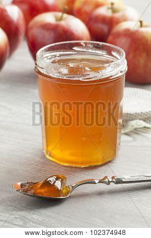 Apple cider jam on a spoon