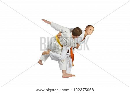 Athlete with orange belt is perfoming throw
