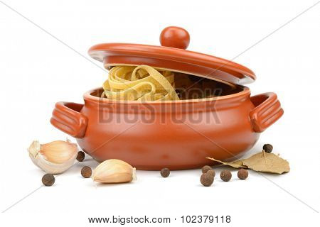 Spaghetti in a clay pot isolated on white