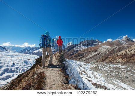 Hikers on the trek in Himalayas Khumbu valley Nepal