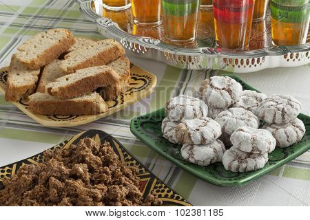 Traditional Moroccan homemade cookies and sellou with tea