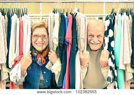 Playful Senior Couple At Weakly Flea Market - Concept Of Active Elderly With Mature Man And Woman