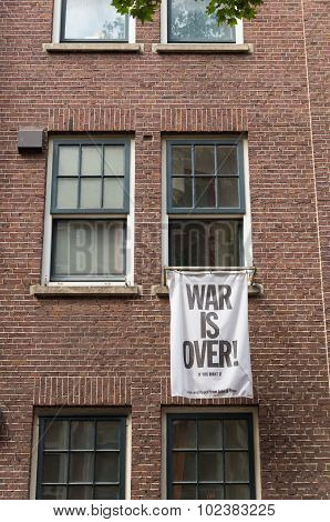 AMSTERDAM, NETHERLANDS - AUGUST 2, 2015: flag on an Amsterdam house with peacefull text